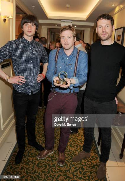 Nick Hodgson Ricky Wilson and Simon Rix of Q Innovation In Sound Winner Kaiser Chiefs pose in the press room at the Q Awards 2011 held at The...