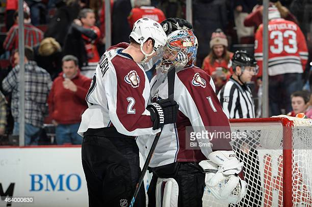 Nick Holden and goalie Semyon Varlamov of the Colorado Avalanche celebrate after defeating the Chicago Blackhawks 41 during the NHL game at the...