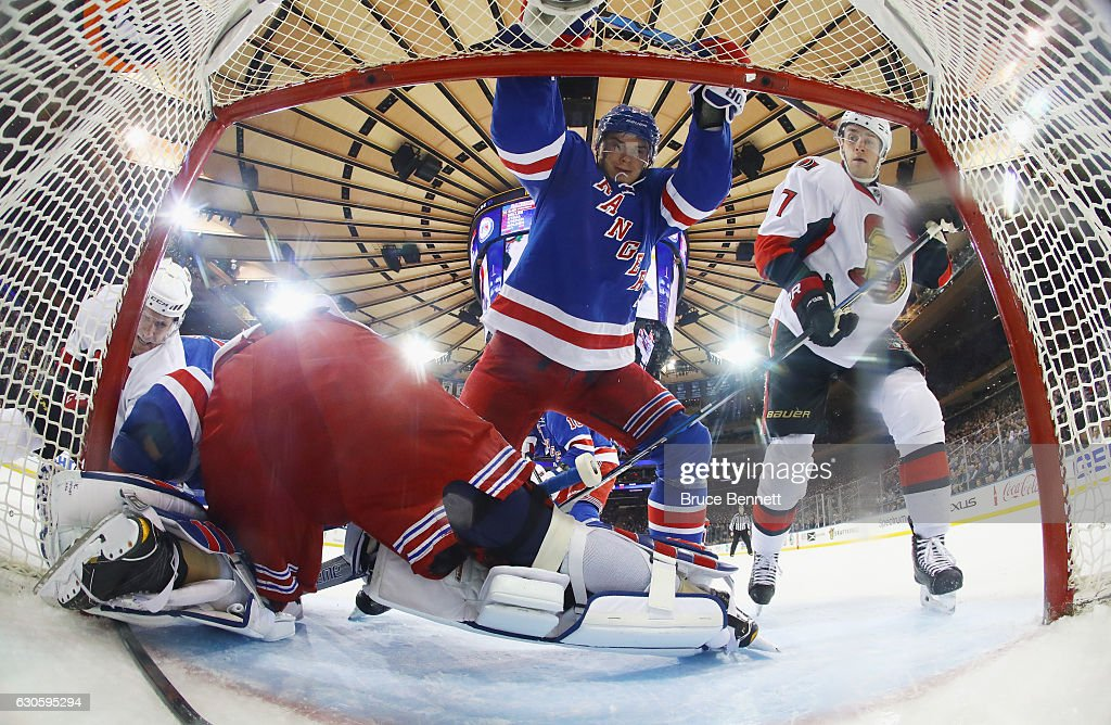 Nick Holden #22 and Kyle Turris #7 of the Ottawa Senators converge in teh crease at Madison Square Garden on December 27, 2016 in New York City. The Rangers defeated the Senators 4-3.