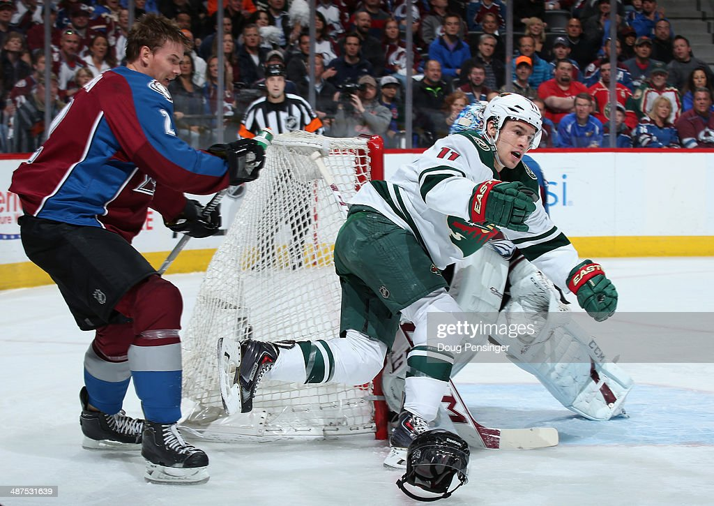 Nick Holden #2 of the Colorado Avalanche looses his helmet and Zach Parise #11 of the Minnesota Wild looses his stick as they collide in Game Seven of the First Round of the 2014 NHL Stanley Cup Playoffs at Pepsi Center on April 30, 2014 in Denver, Colorado.