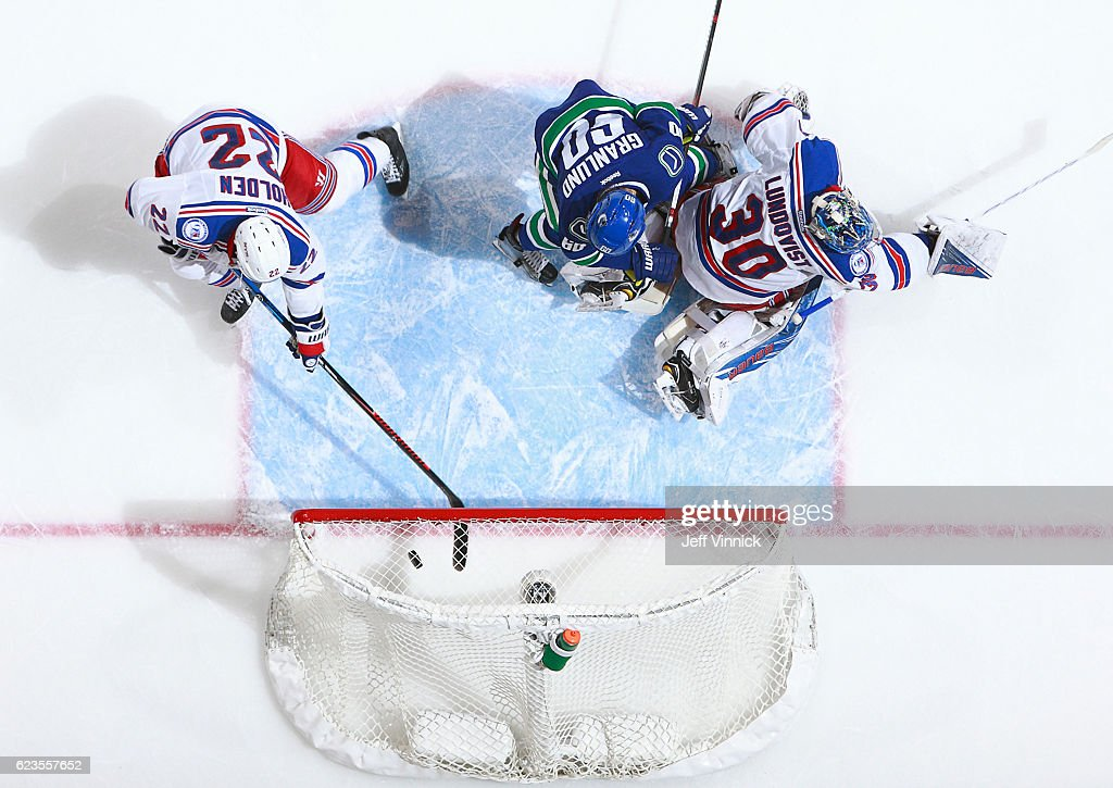 Nick Holden #22 of the New York Rangers is too late as Markus Granlund #60 of the Vancouver Canucks scores on Henrik Lundqvist #30 of the Rangers during their NHL game at Rogers Arena November 15, 2016 in Vancouver, British Columbia, Canada. New York won 7-2.