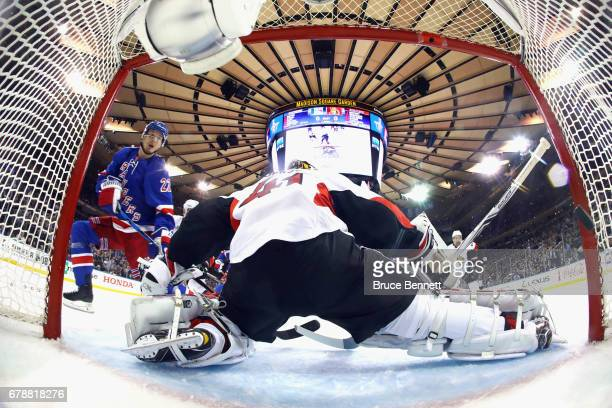 Nick Holden of the New York Rangers scores a first period goal past Craig Anderson of the Ottawa Senators in Game Four of the Eastern Conference...