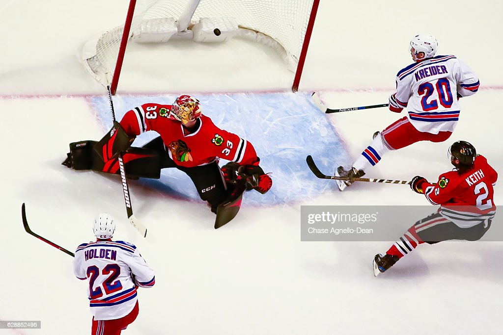 New york rangers v chicago blackhawks photos and images getty images nick holden 22 of the new york rangers scores the game winning goal in overtime publicscrutiny Image collections