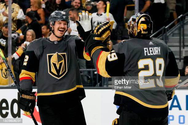 Nick Holden of the Vegas Golden Knights is congratulated by Marc-Andre Fleury after scoring a goal against the Montreal Canadiens during the third...