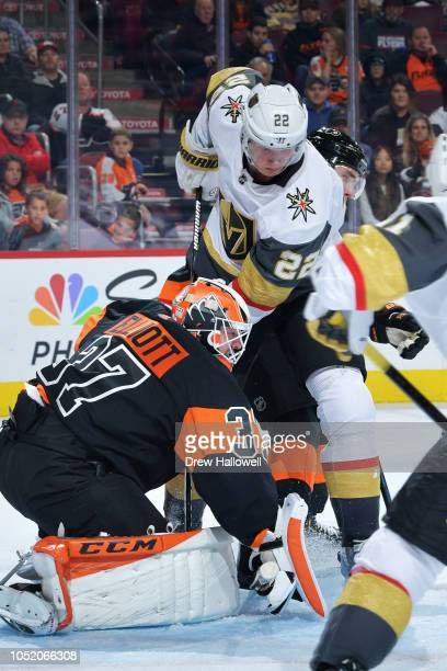 Nick Holden of the Vegas Golden Knights tries to jam the puck past Brian Elliott of the Philadelphia Flyers at the Wells Fargo Center on October 13...