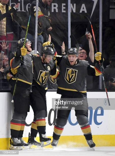 Nick Holden Reilly Smith and Paul Stastny of the Vegas Golden Knights celebrate after Stastny assisted Smith on a thirdperiod goal against the...