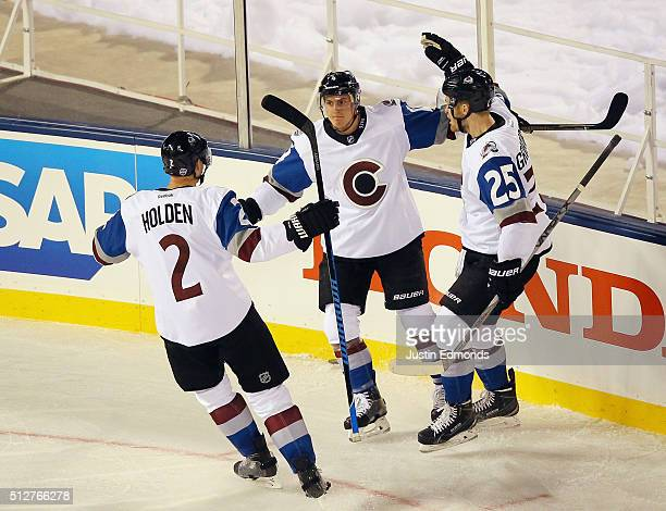 Nick Holden Tyson Barrie and Mikhail Grigorenko of the Colorado Avalanche celebrate Barrie's first period goal against the Detroit Red Wings at Coors...