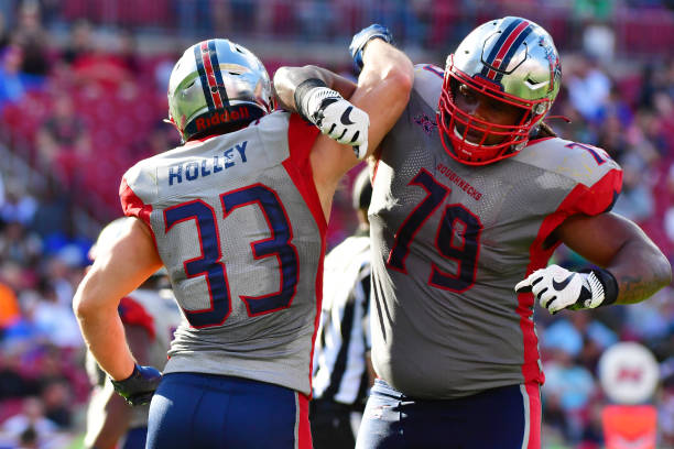 Nick Holley of the Houston Roughnecks and Terry Poole II celebrate after a 2point conversion during the fourth quarter against the Tampa Bay Vipers...