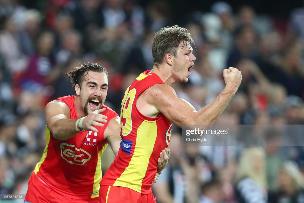 Nick Holman of the Suns celebrates a goal during the round 15 AFL match between the Gold Coast Suns and the Collingwood Magpies at Metricon Stadium on June 30, 2018 in Gold Coast, Australia.