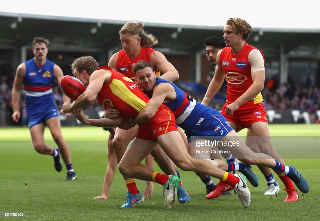 Nick Holman of the Suns is challenged by Hayden Crozier of the Bulldogs during the round seven AFL match between the Western Bulldogs and the Gold Coast Suns at Mars Stadium on May 5, 2018 in Ballarat, Australia.
