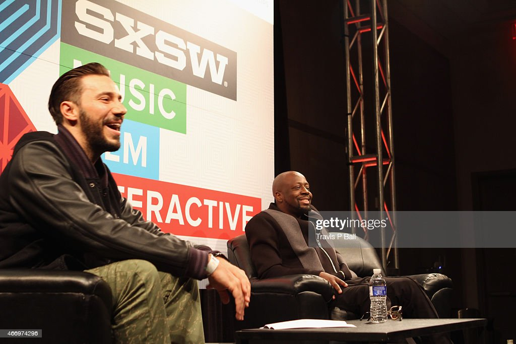 Nick Huff Barili and recording artist Wyclef Jean attend 'SXSW Interview: Wyclef Jean' during the 2015 SXSW Music, Film + Interactive Festival at Austin Convention Center on March 19, 2015 in Austin, Texas.