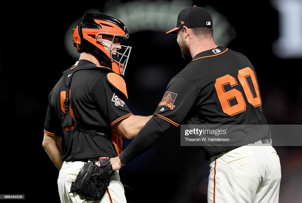 Nick Hundley #5 and Hunter Strickland #60 of the San Francisco Giants celebrates defeating the Philadelphia Phillies 2-0 at AT&T Park on June 2, 2018 in San Francisco, California.