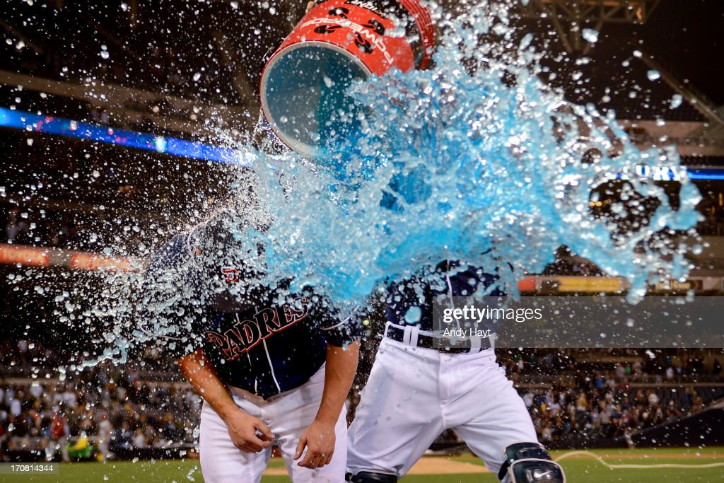 Nick Hundley #4 douses Eric Stults #53 of the San Diego Padres with gatorade after the game against the Arizona Diamondbacks at Petco Park on June 14, 2013 in San Diego, California.