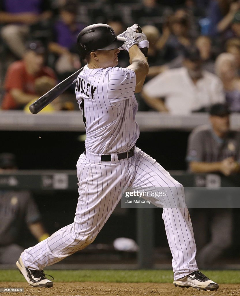 Nick Hundley #4 of the Colorado Rockies hits a grand slam home run against the Arizona Diamondbacks in the eighth inning at Coors Field on September 2, 2016 in Denver, Colorado.
