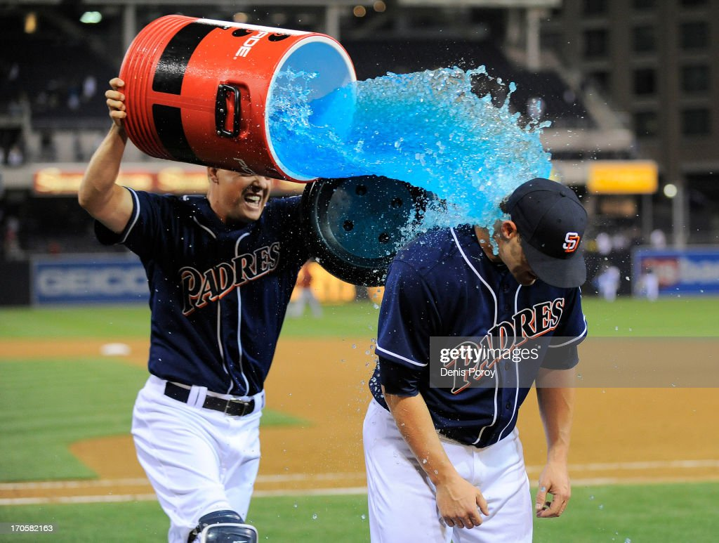 Nick Hundley #4 of the San Diego Padres dumps a cooler of Gatorade on Eric Stults #53 after the Padres beat the Arizona Diamondbacks 2-1 in a baseball game at Petco Park on June 14, 2013 in San Diego, California.