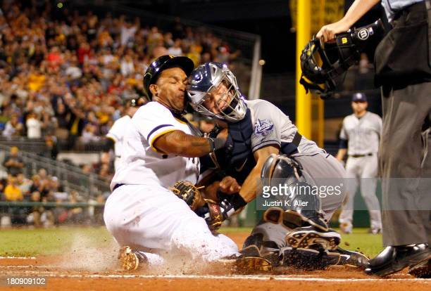 Nick Hundley of the San Diego Padres tags out Marlon Byrd of the Pittsburgh Pirates in the third inning during the game on September 17 2013 at PNC...