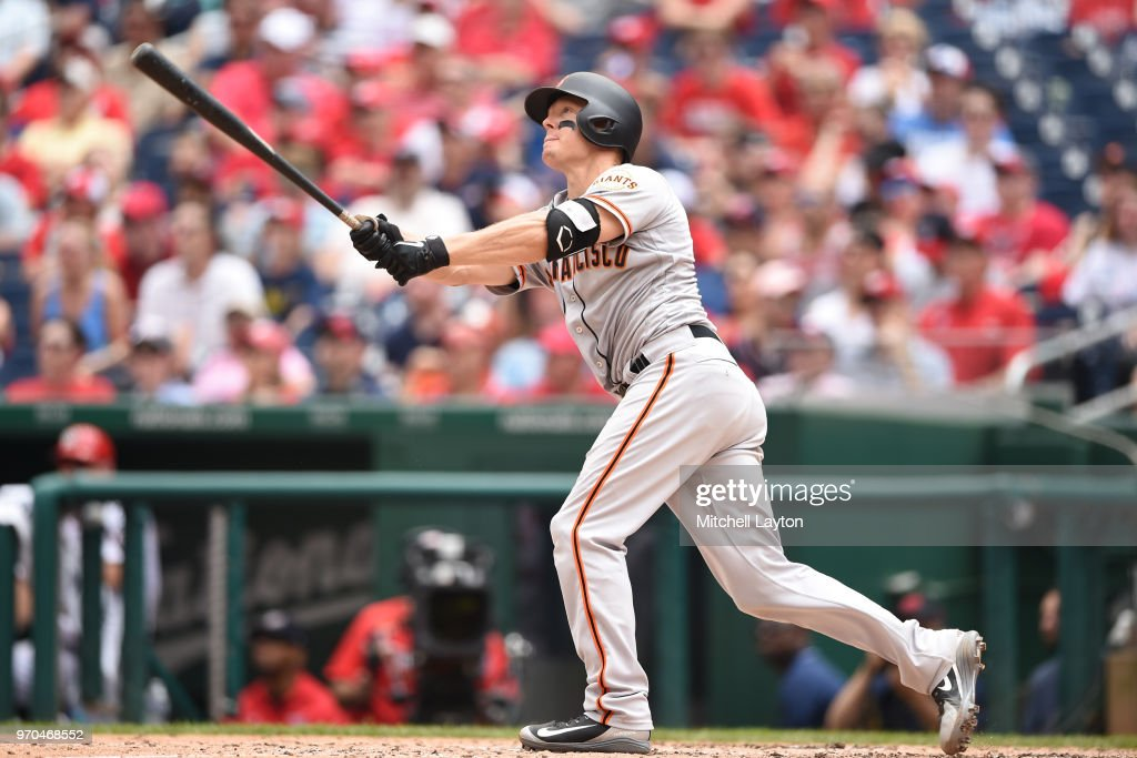 Nick Hundley #5 of the San Francisco Giants hits a three run home run in the third inning during a baseball game against the Washington Nationals at Nationals Park on June 9, 2018 in Washington, DC.