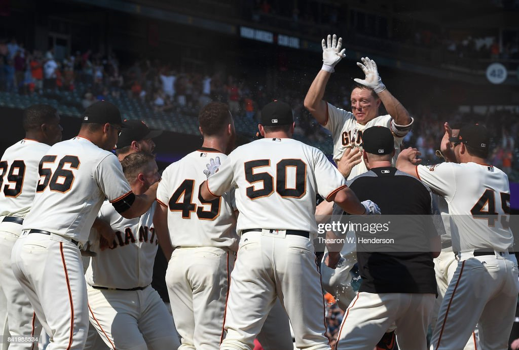 Nick Hundley #5 of the San Francisco Giants jumps in the air at home plate celebrating with teammates after he hit a walk off solo home run against the St. Louis Cardinals in the bottom of the tenth inning at AT&T Park on September 2, 2017 in San Francisco, California. The Giants won the game 2-1.