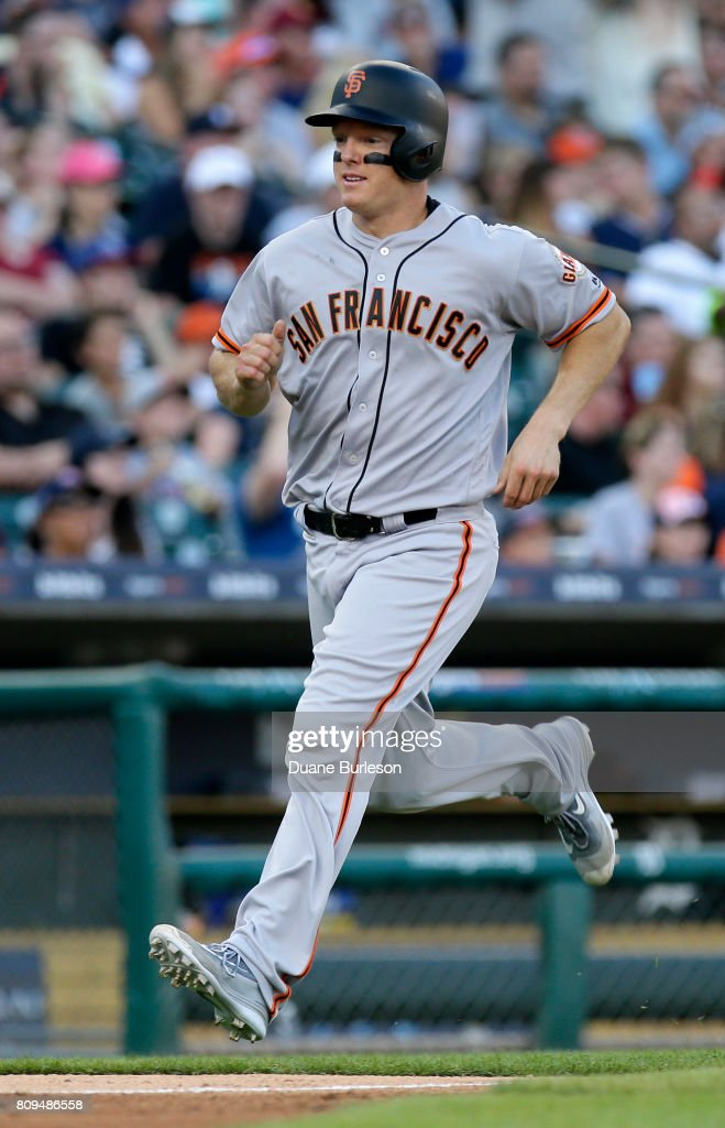 Nick Hundley #5 of the San Francisco Giants scores from second base on a single by Brandon Belt of the San Francisco Giants during the fourth inning at Comerica Park on July 5, 2017 in Detroit, Michigan. The Giants defeated the Tigers 5-4.