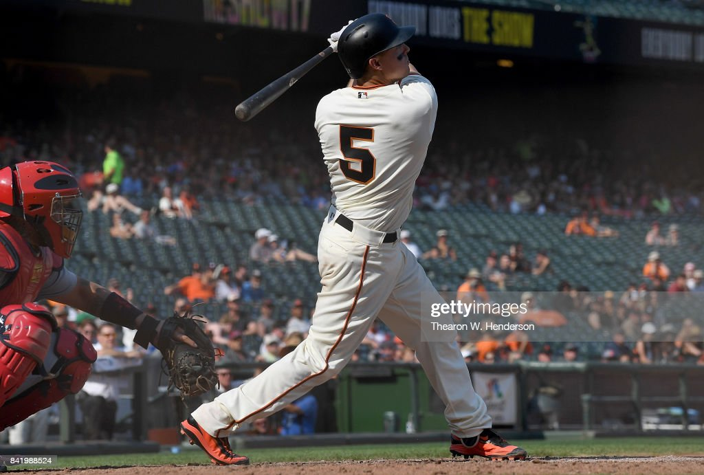 Nick Hundley #5 of the San Francisco Giants swings and watches the flight of his ball as he hits a walk off solo home run against the St. Louis Cardinals in the bottom of the tenth inning at AT&T Park on September 2, 2017 in San Francisco, California. The Giants won the game 2-1.
