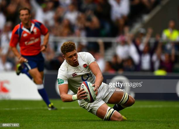 Nick Isiekwe of England goes over to score his side's second try during the Old Mutual Wealth Cup match between England and The Barbarians at...