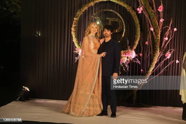 Nick Janoss brother Joe Jonas with his fiancé Sophie Turner pose for photos during wedding reception of Bollywood actor Priyanka Chopra and American...