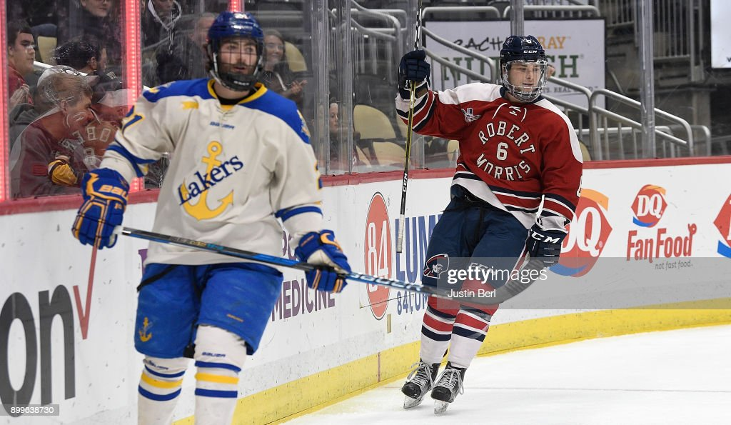 Nick Jenny #6 of the Robert Morris Colonials celebrates after scoring his first career NCAA goal in the second period during the game against the Lake Superior Lakers at PPG PAINTS Arena on December 29, 2017 in Pittsburgh, Pennsylvania.