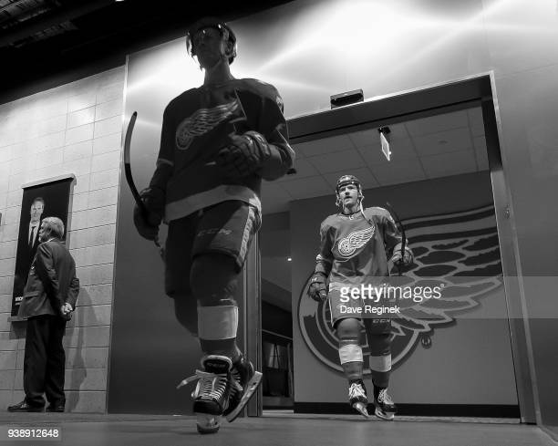 Nick Jensen and Joe Hicketts of the Detroit Red Wings walk out of the locker room to the ice prior to warmups before an NHL game against the...