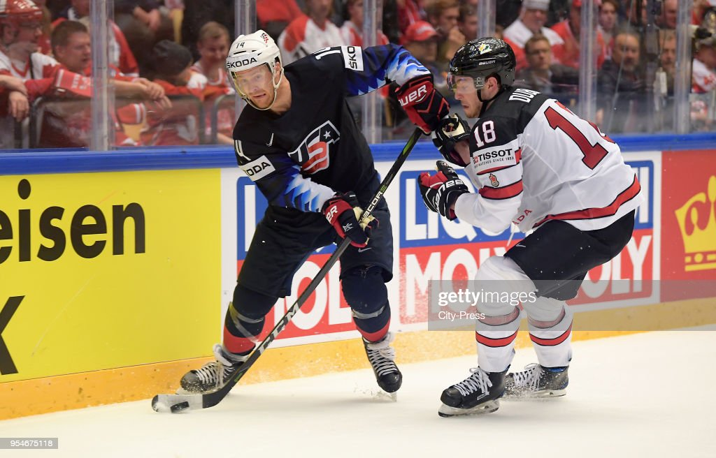Nick Jensen of Team USA and Pierre-Luc Dubois of Team ...