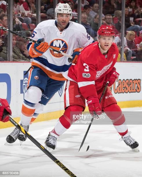 Nick Jensen of the Detroit Red Wings battles for position with Johnny Boychuk of the New York Islanders during an NHL game at Joe Louis Arena on...