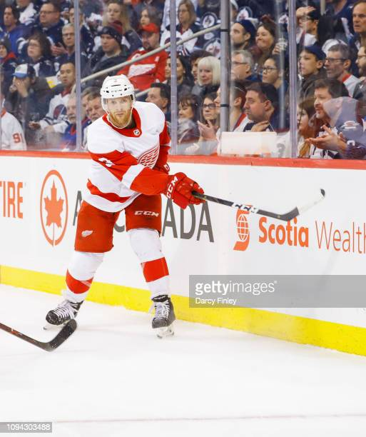 Nick Jensen of the Detroit Red Wings keeps an eye on the play during first period action against the Winnipeg Jets at the Bell MTS Place on January...