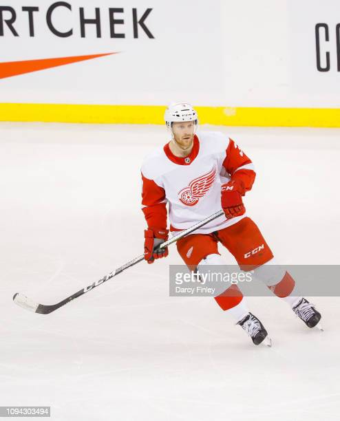 Nick Jensen of the Detroit Red Wings keeps an eye on the play during second period action against the Winnipeg Jets at the Bell MTS Place on January...