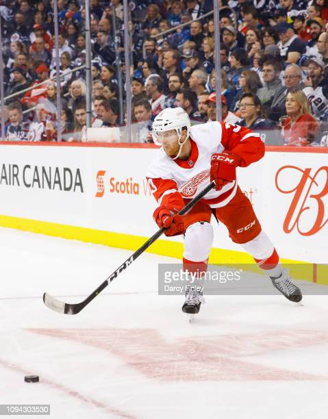 Nick Jensen of the Detroit Red Wings passes the puck up the ice during first period action against the Winnipeg Jets at the Bell MTS Place on January...