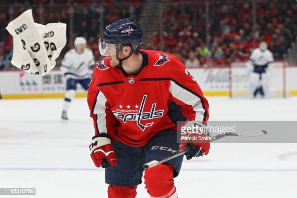 Nick Jensen of the Washington Capitals skates down the ice after having a towel stuck to his skate against the Tampa Bay Lightning during the first...