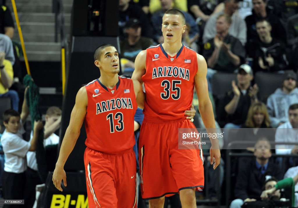 Nick Johnson #13 and Kaleb Tarczewski #35 of the Arizona Wildcats walk off the court during the second half of the game against the Oregon Ducks at Matthew Knight Arena on March 8, 2014 in Eugene, Oregon. Oregon won the game 64-57.