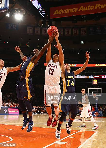 Nick Johnson of the Arizona Wildcats battles for the ball against Stevan Manojlovic and Damion Lee of the Drexel Dragons during their Semi Final game...