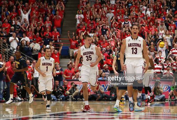 Nick Johnson of the Arizona Wildcats celebrates after scoring against the California Golden Bears during the first half of the college basketball...