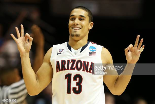 Nick Johnson of the Arizona Wildcats celebrates in the second half of their 84 to 61 win over the Gonzaga Bulldogs during the third round of the 2014...