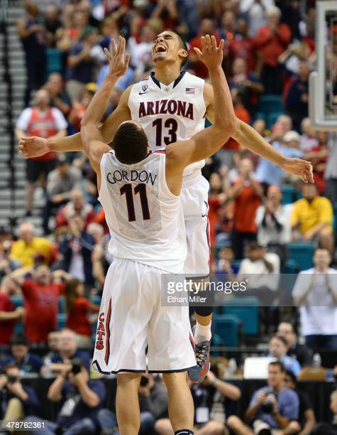 Nick Johnson of the Arizona Wildcats celebrates with teammate Aaron Gordon after Johnson hit a 3pointer against the Colorado Buffaloes during a...