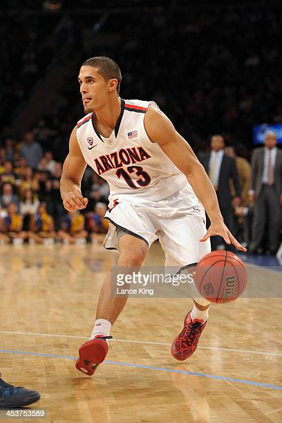Nick Johnson of the Arizona Wildcats dribbles against the Drexel Dragons during their semifinal game of the NIT Season TipOff at Madison Square...