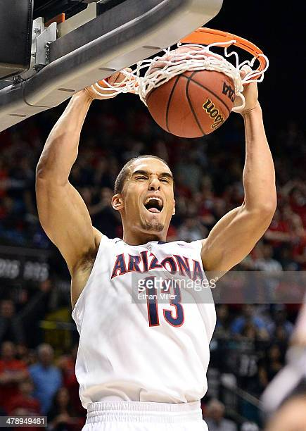 Nick Johnson of the Arizona Wildcats dunks against the UCLA Bruins during the championship game of the Pac12 Basketball Tournament at the MGM Grand...