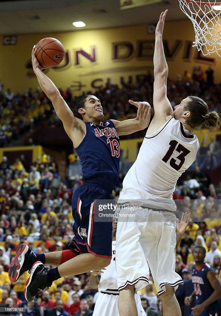 Nick Johnson #13 of the Arizona Wildcats goes up for a shot against Jordan Bachynski #13 of the Arizona State Sun Devils during the college basketball game at Wells Fargo Arena on January 19, 2013 in Tempe, Arizona. The Wildcats defeated the Sun Devils 71-54.