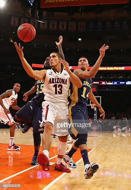 Nick Johnson of the Arizona Wildcats grabs a rebound against Damion Lee of the Drexel Dragons during their Semi Final game of the NIT Season Tip Off...