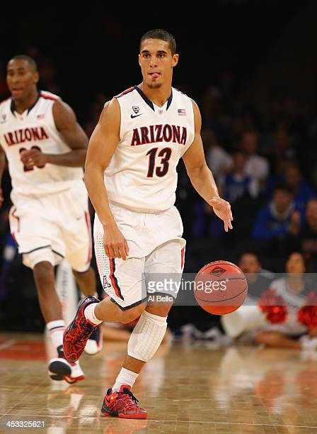 Nick Johnson of the Arizona Wildcats in action against the Drexel Dragons during their Semi Final game of the NIT Season Tip Off at Madison Square...