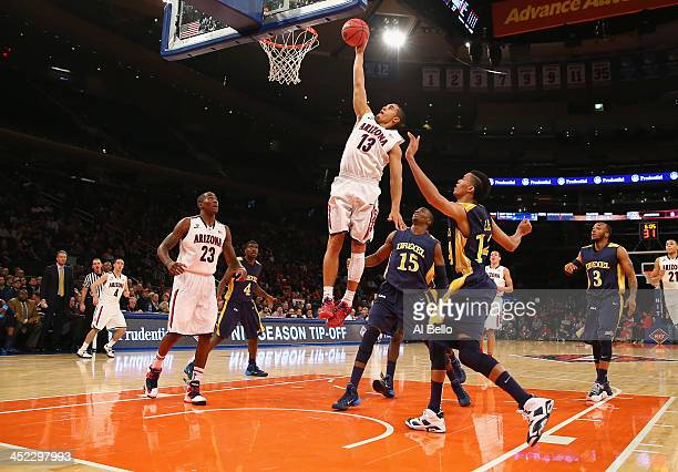 Nick Johnson of the Arizona Wildcats scores against the Drexel Dragons during their Semi Final game of the NIT Season Tip Off at Madison Square...