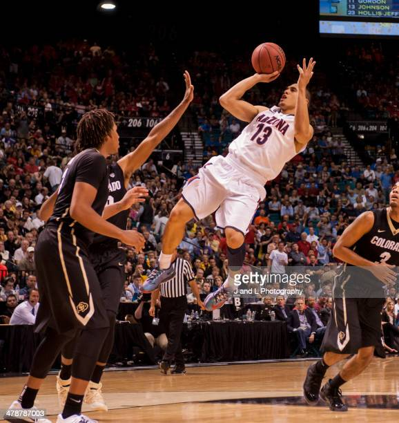 Nick Johnson of the Arizona Wildcats shoots a fadeaway jumper over Xavier Johnson of the Colorado Buffaloes during a semifinal game of the Pac12...