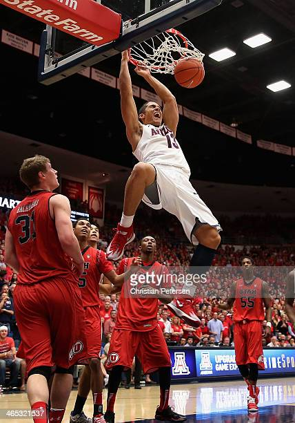 Nick Johnson of the Arizona Wildcats slam dunks the ball over Dakarai Tucker of the Utah Utes during the second half of the college basketball game...