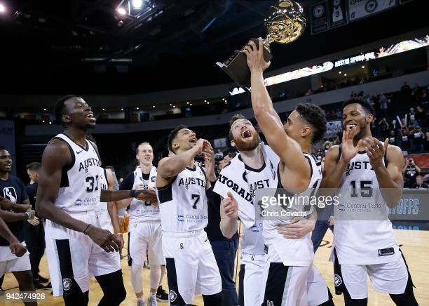 Nick Johnson of the Austin Spurs holding the Western Conference Champion trophy celebrates with his teammates after defeating the South Bay Lakers...