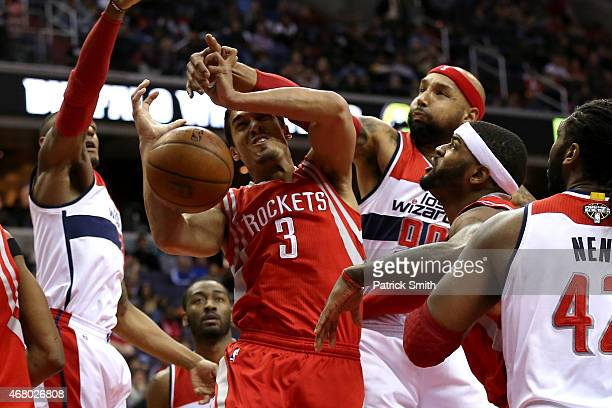 Nick Johnson of the Houston Rockets has his shot blocked by Drew Gooden of the Washington Wizards in the first half at Verizon Center on March 29...