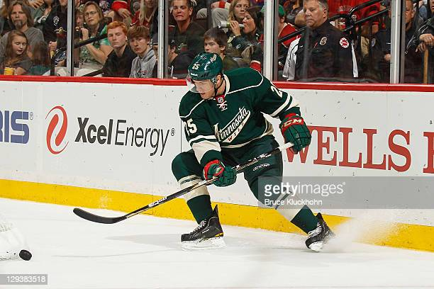 Nick Johnson of the Minnesota Wild skates with the puck against the Columbus Blue Jackets during the game at the Xcel Energy Center on October 8 2011...